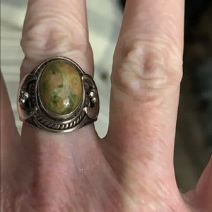 Sterling silver ring with olive green stone